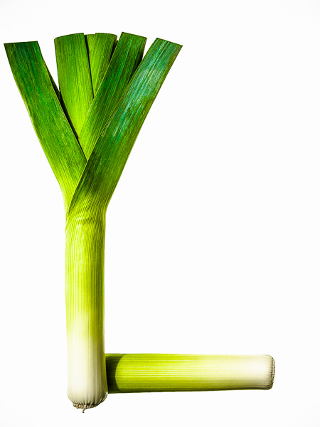 """Photo of Leeks, laid out in the shape of the letter """"L"""""""