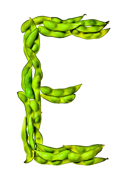 """Photo of Edamame, laid out in the shape of the letter """"E"""""""
