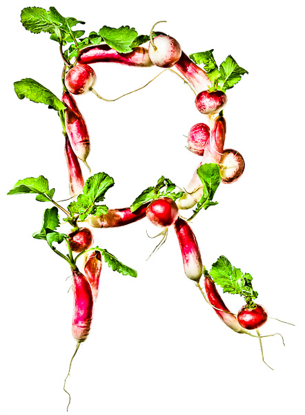 """Photo of Radishes, laid out in the shape of the letter """"R"""""""