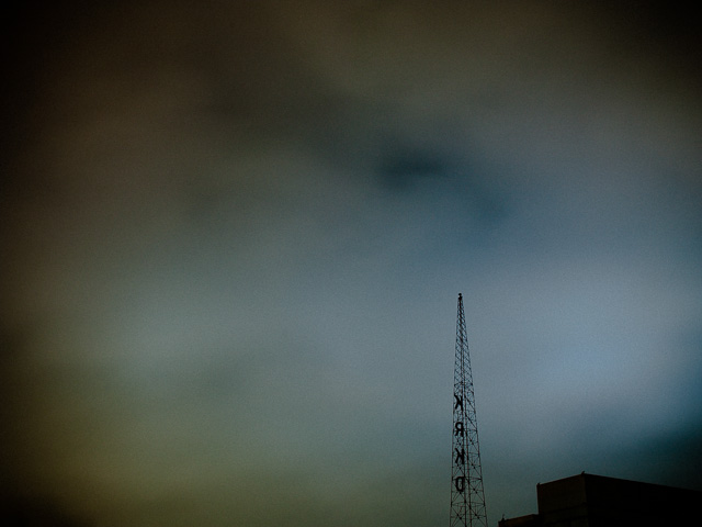 Atmospheric Image of a Radio Tower surrounded by clouds. © Dana Hursey Photography