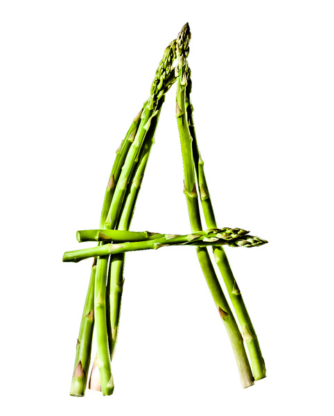 "Photo of Asparagus laid out in the shape of the letter ""A"""