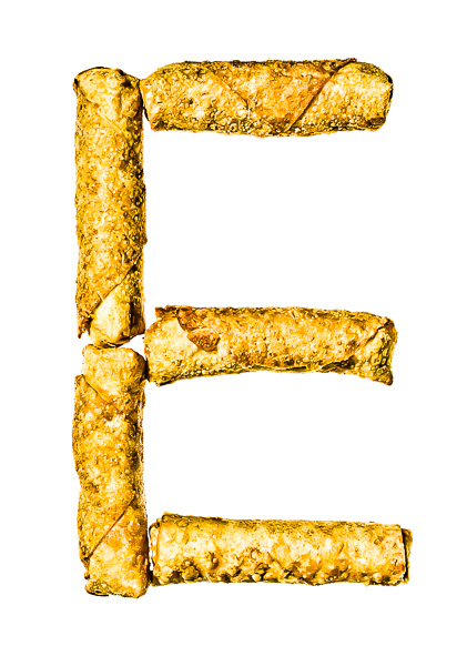 "Photo of Egg Rolls, laid out in the shape of the letter ""E"""