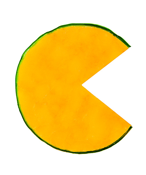 "A cheese wheel with a wedge cut out so as to form the letter ""C"""