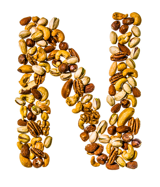 "Photo of Nuts, laid out in the shape of the letter ""N"""