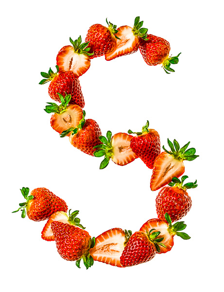 "Photo of Sliced Strawberries, laid out in the shape of the letter ""S"""