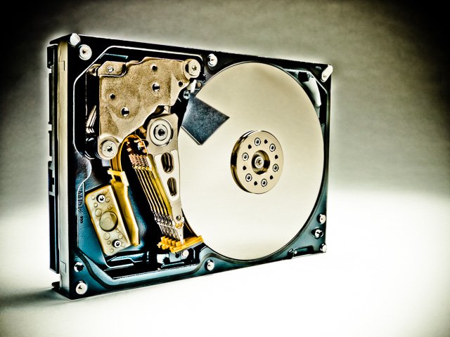 Photograph of the inside of a hard disk drive.