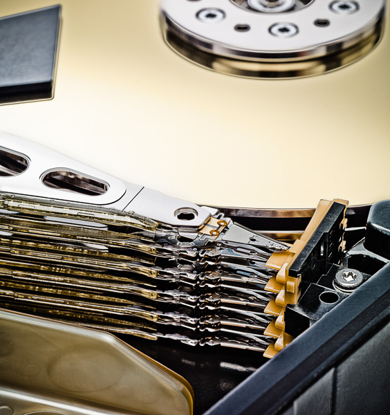 Detail Photograph of the inside of a hard disk drive.