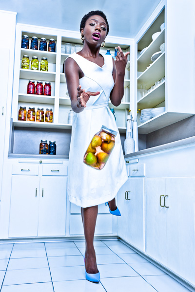 Fashion image of a woman dropping a jar of preserved fruit. © 2014 Dana Hursey Photography