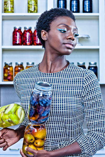 Fashion image of woman with jars of preserved fruit. © 2014 Dana Hursey Photography