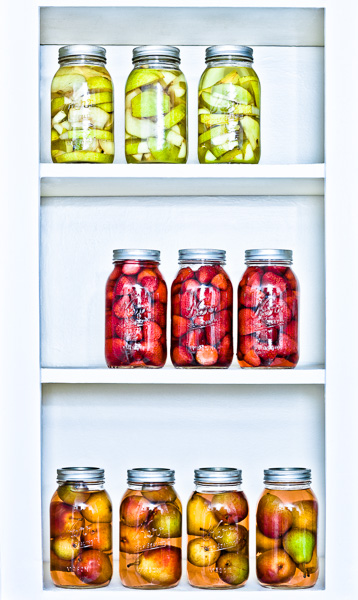 Images of preserves on a shelf. © 2014 Dana Hursey Photography
