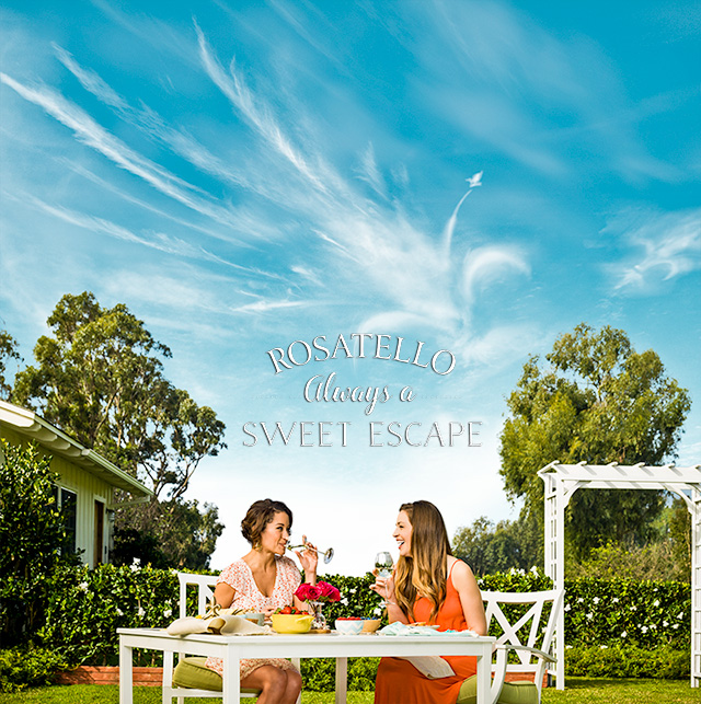 Photo of two women enjoying Rosatello Wine in a backyard setting