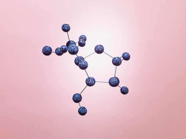 Photo of blueberries creating a molecular structure.