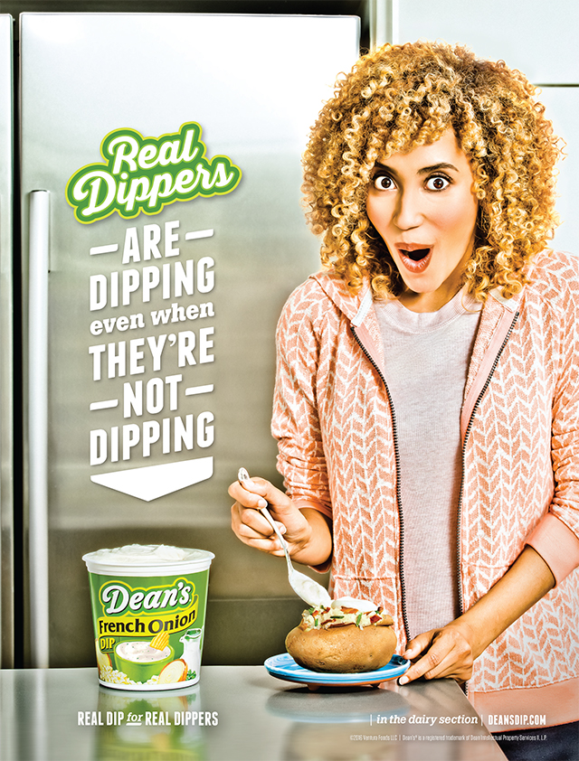Photograph of woman topping a baked potato with Dean's Dip