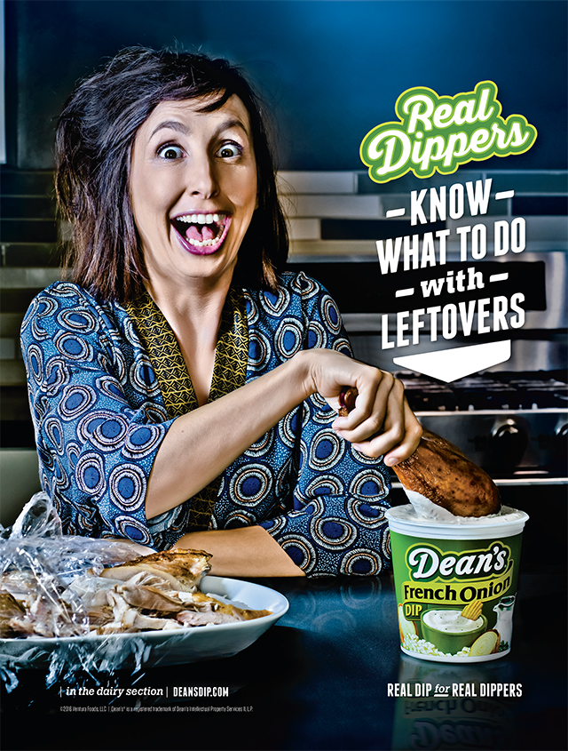Photograph of woman dipping a turkey leg into a tub of Dean's Dip