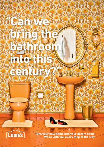 Photograph of a1970's decorated bathroom with gaudy wallpaper and orange and gold accents. for Lowe's Home Improvement.