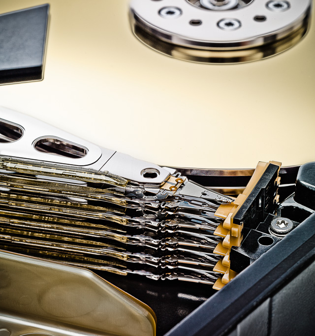 Macro Photograph of the inside of a computer hard disk drive.